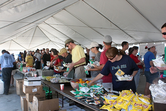 Volunteers get ready to eat lunch on Courthouse Road in Gulfport at the 2011 Coastal Cleanup. That's a huge tent!