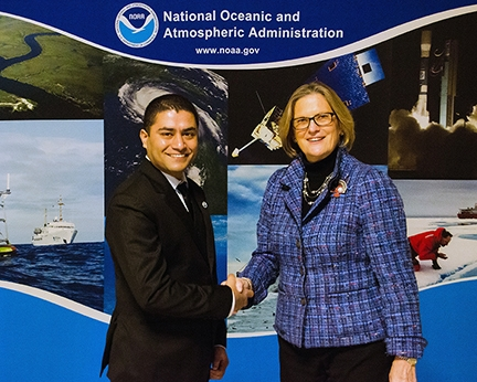Shailesh Sharma, left, with NOAA Administrator Kathryn Sullivan.