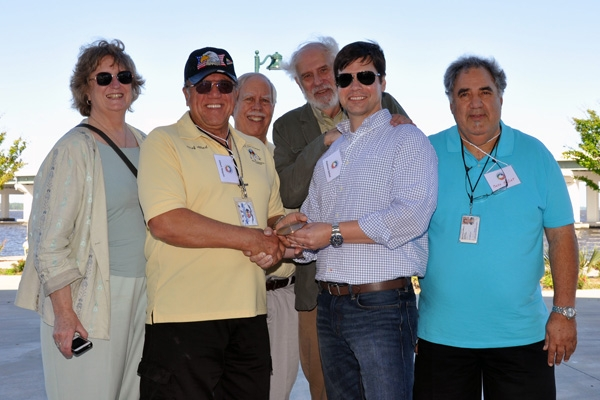 Kristina Peterson of Lowlander Center, left, Isle de Jean Charles Chief Albert Naquin, friend of the tribe Ed Cake, Dick Krajeski of Lowlander Center, Matt Bethel of Louisiana Sea Grant (presenting the award) and Deputy Chief Wenceslaus Billiot.