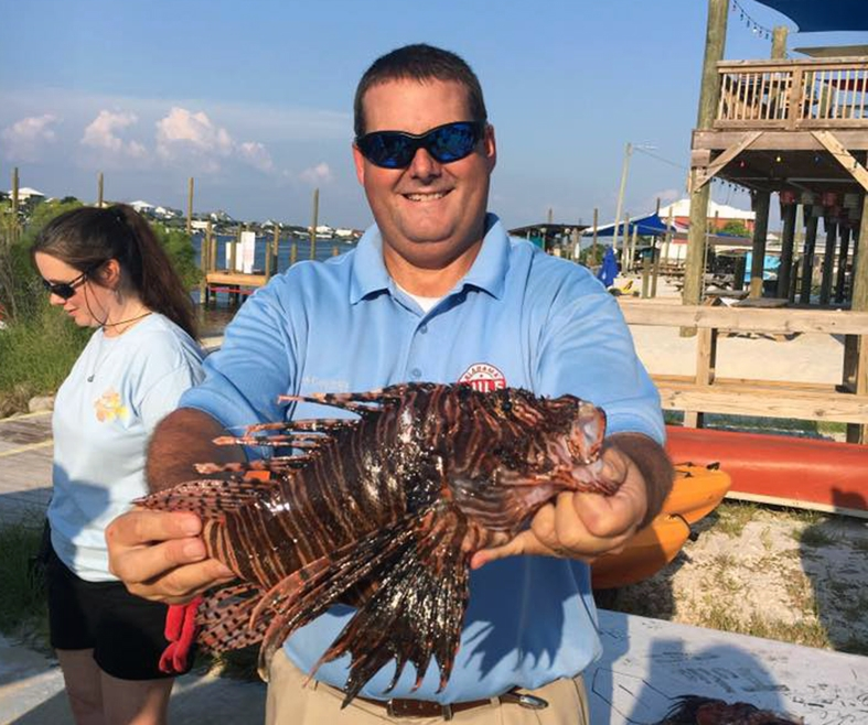 (Photo submitted by Chris Blankenship) Alabama Marine Resources Division Director Chris Blankenship shows off the third-largest lionfish, which was nearly 16 inches long.