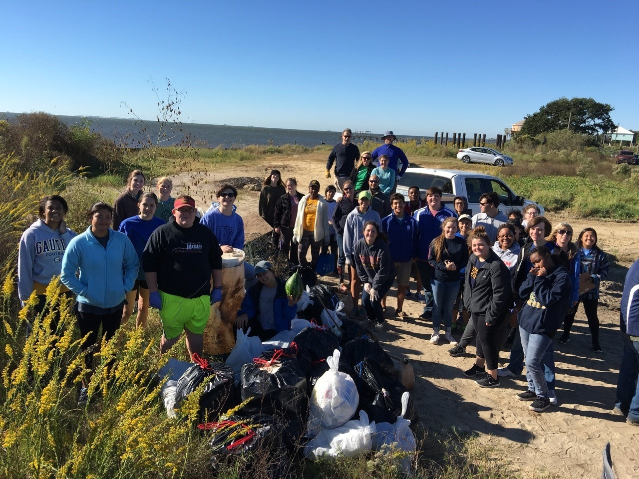 Mississippi Coastal Cleanup volunteers and their trash at Graveline Bayou (Photo by Janet Wright).