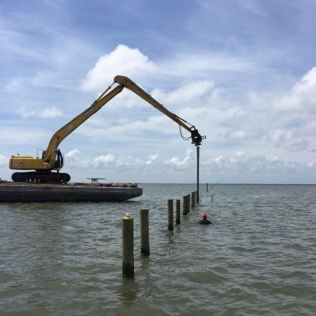 Pilings are installed in Grand Bay Oyster Park, a new oyster farming park in Alabama. Photo credit: Bill Walton