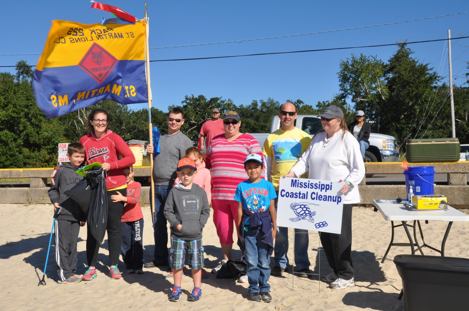 A group from St. Martin, Miss., poses for a photo during the 2016 Mississippi Coastal Cleanup event.