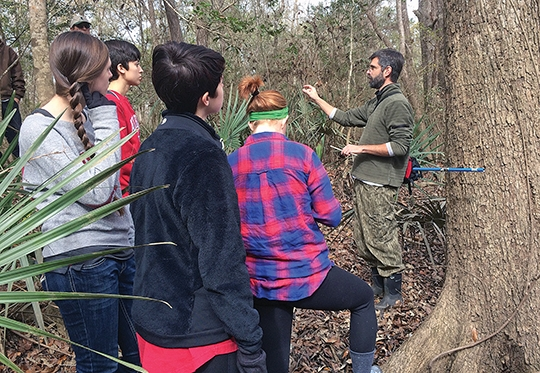 Professor Matthew Therrell, of the University of Alabama, teaches students about collecting tree ring samples.