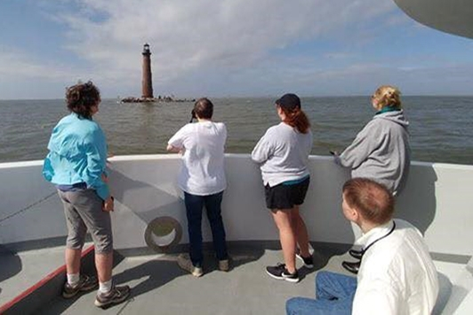 Field learning was part of the event. EEAA attendees enjoyed this field trip to Mobile Bay.