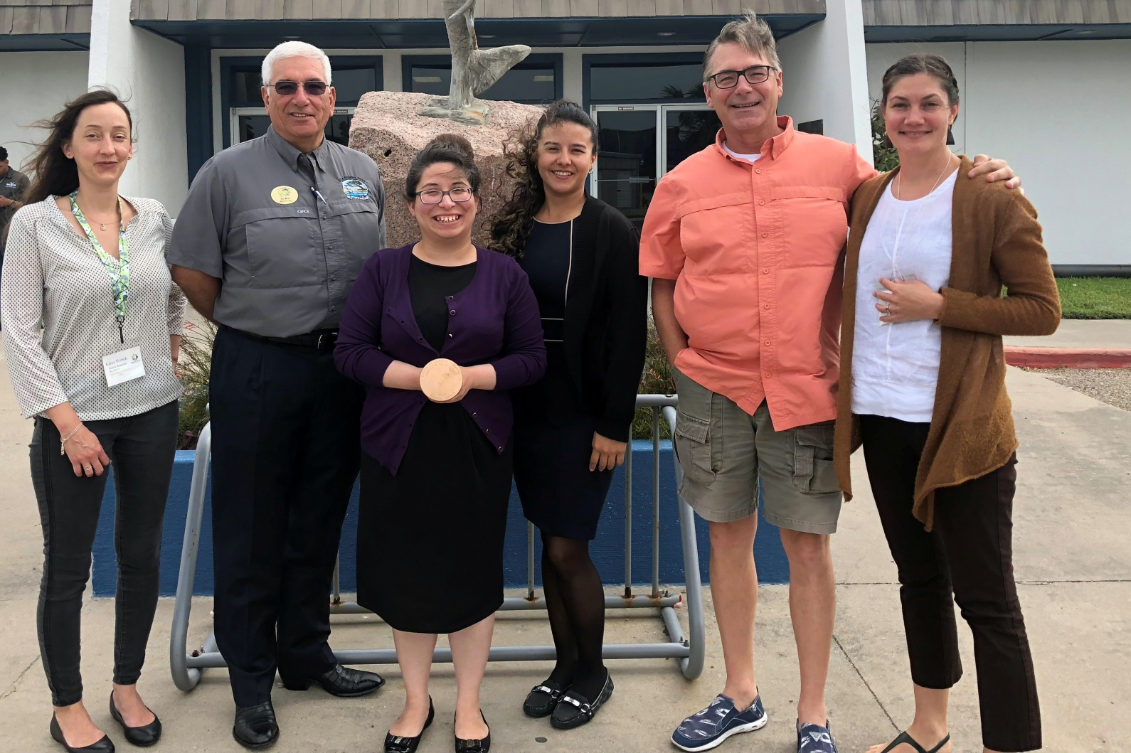 Rockport Community Planner Amanda Torres, third from left, accepts the Spirit of Community Award recently during the Gulf of Mexico Climate and Resilience Community of Practice's annual meeting in Port Aransas, Texas.