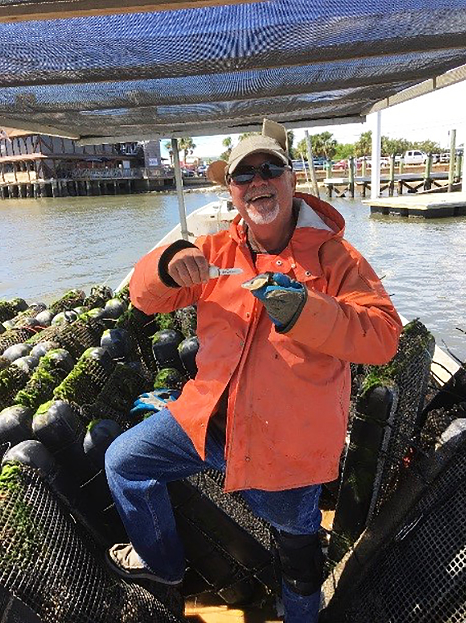 Dennis David of Indian River Oyster Company visits Southern Cross Sea Farms in Cedar Key, Florida.