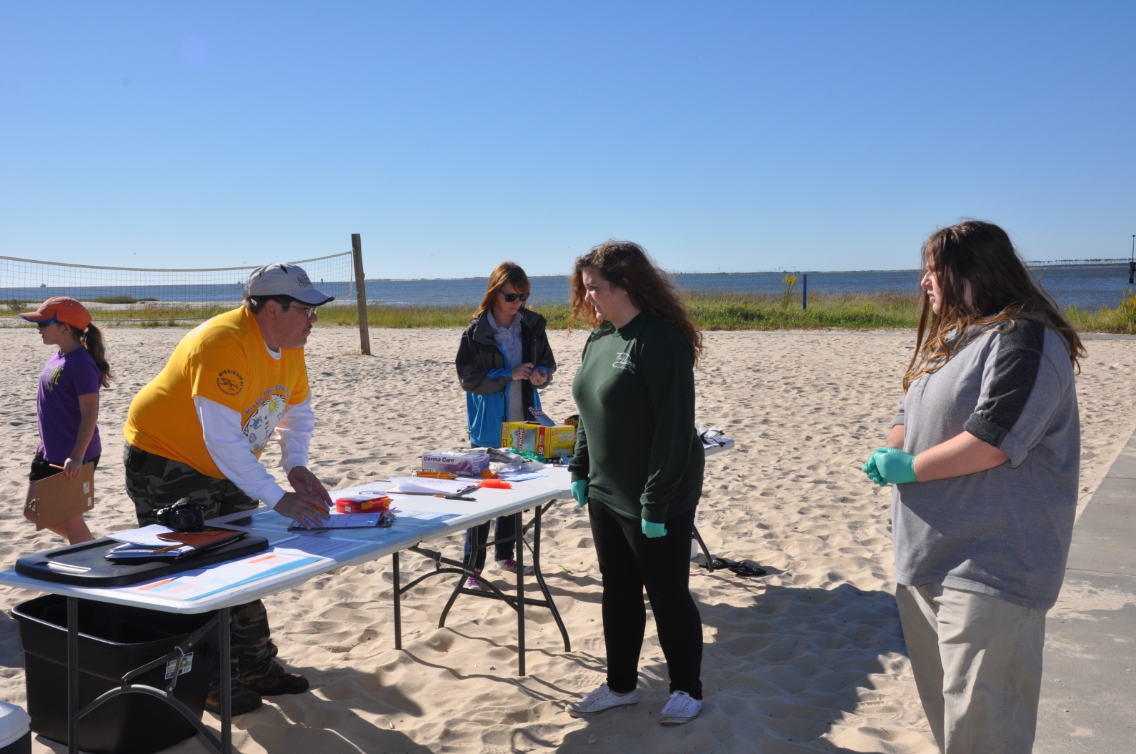 Master Naturalist Randy Hines, left, mans the registration table on Front Beach in Ocean Springs during the Mississippi Coastal Cleanup 2016.