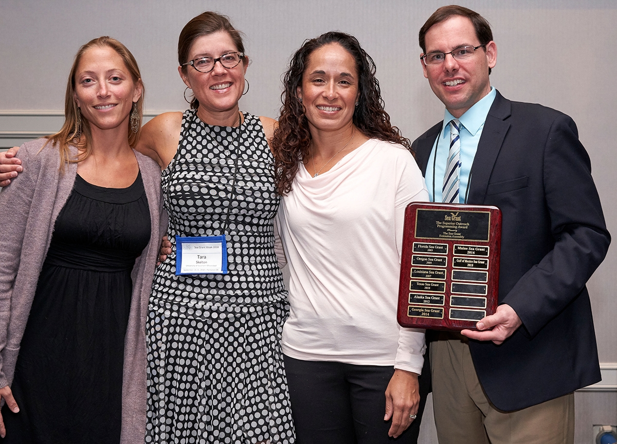 The Sea Grant Gulf of Mexico Oil Spill Science Outreach Team receives the National Superior Outreach Programming Award. Pictured are Chris Hale, left, Tara Skelton, Monica Wilson and Steve Sempier. (Photo by James Dewhirst)