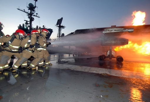 A primary cause of PFAS contamination at sites in Alabama and Mississippi is military use of PFAS-containing fire-fighting foam and other products. (Photo from www.secnav.navy.mil)