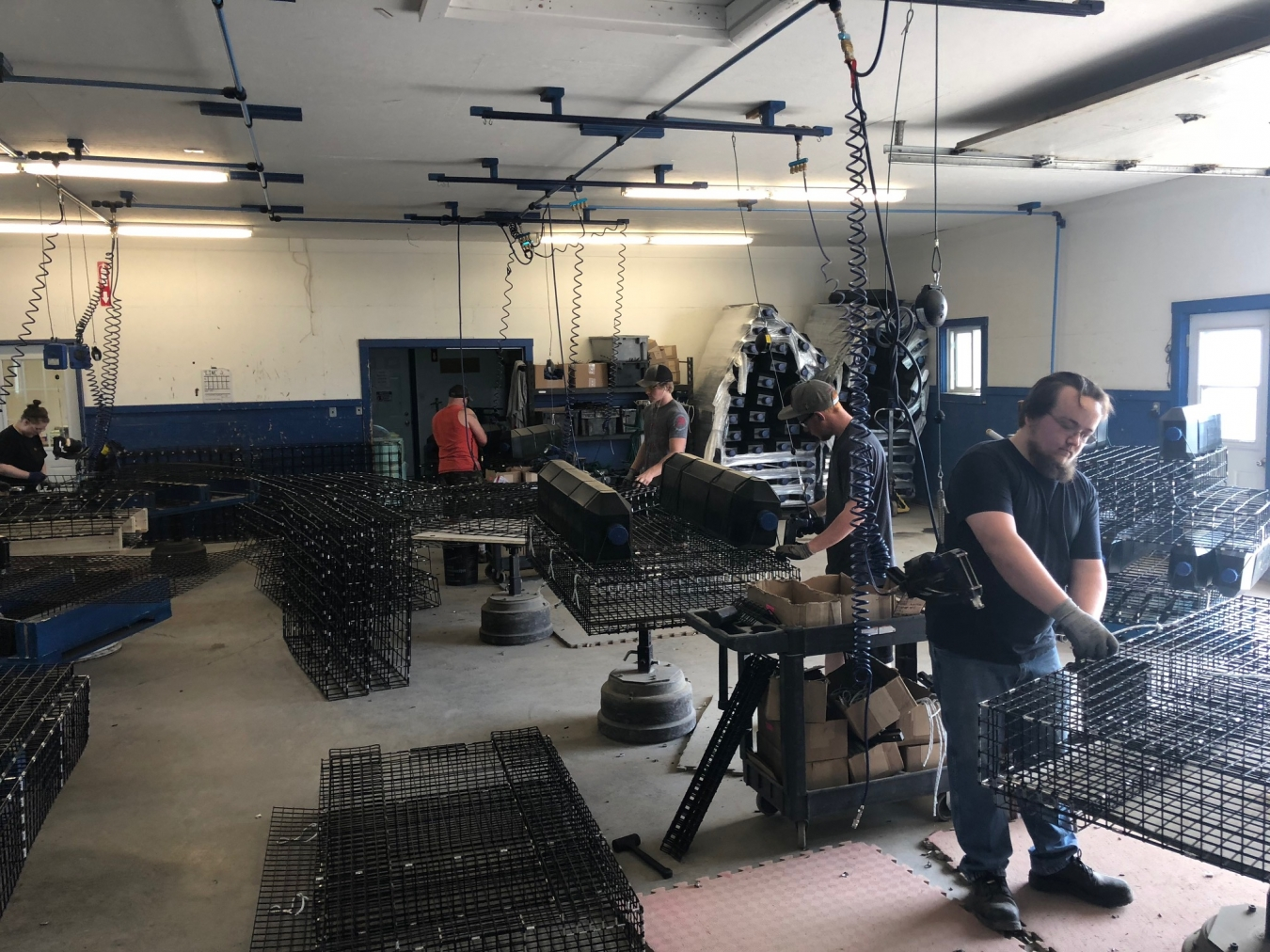 Workers build oyster cages at a gear manufacturer in Bouctouche, Canada. (Photo courtesy of Gage Swann)