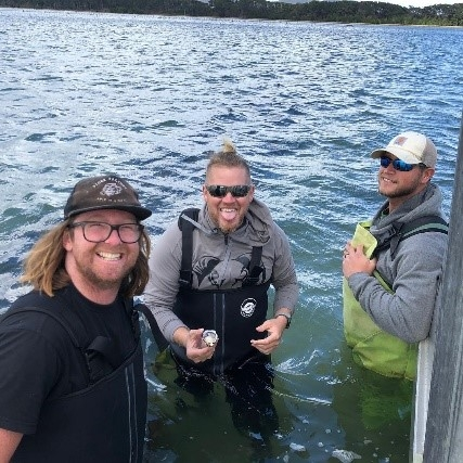 Lane Zirlott, center, and Eric Stewart, right, of Murder Point Oyster Company in Alabama visit Bad Bay Oyster Company in South Bruny, Tasmania.